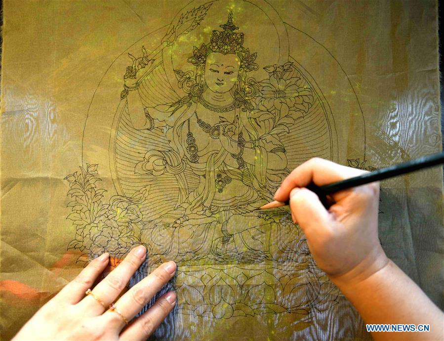 Craftswoman Liu Yuxia creates an embroidery work at her studio in Qiaoxi District of Shijiazhuang, north China\'s Hebei Province, April 4, 2019. Liu Yuxia is an inheritor of Xu embroidery, which was listed as one of Shijiazhuang\'s intangible cultural heritages in 2018. Based on traditional Chinese embroidery skills, her works of unique style present the integration of Chinese and western painting techniques and photography. (Xinhua/Chen Qibao)