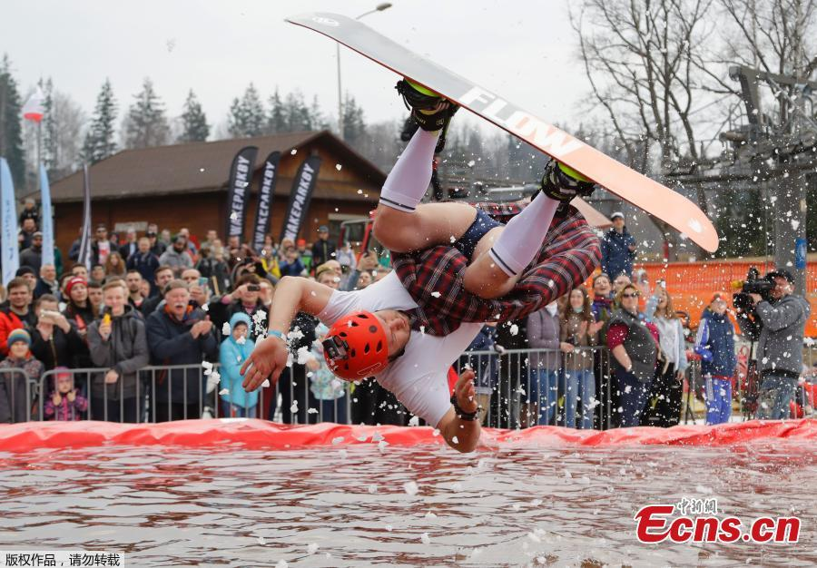 A snowboarder takes part in the comic competition \