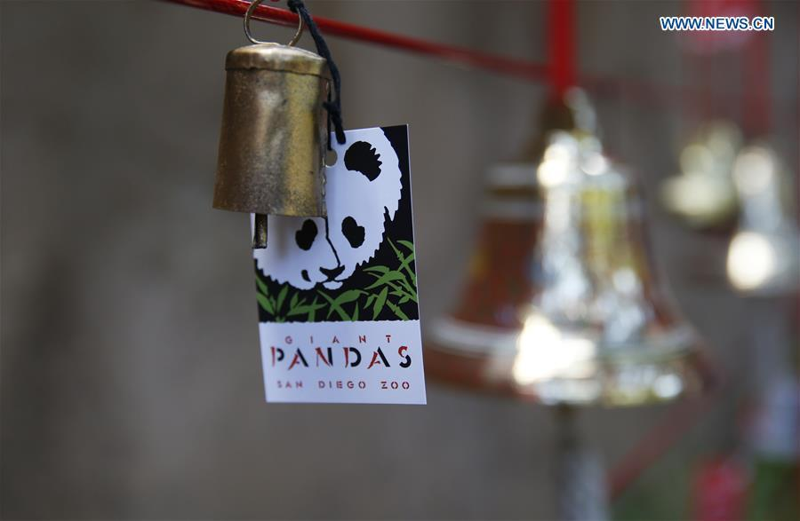 A wishing sign is seen on the Giant Panda Friendship Wall in San Diego Zoo in San Diego, the United States, April 6, 2019. The San Diego Zoo in the U.S. state of California held a special ceremony on Saturday to kick off a three-week farewell event for two giant pandas. Twenty-seven-year-old female giant panda Bai Yun and her son, six-year-old Xiao Liwu, will leave the zoo in late April and be sent back to China, as the zoo\'s conservation loan agreement with China has ended. (Xinhua/Li Ying)