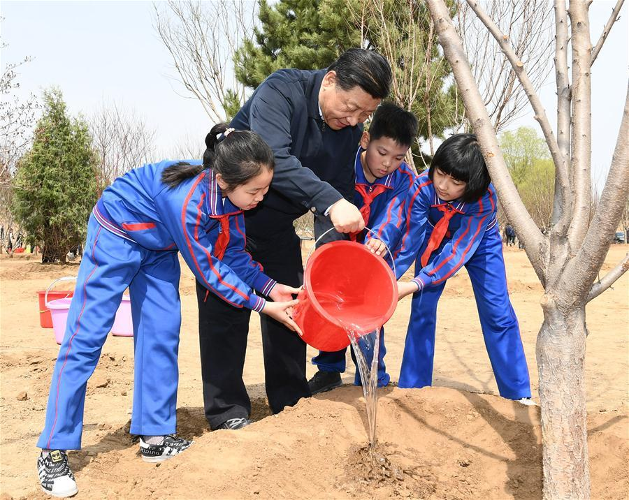 Chinese President Xi Jinping, also general secretary of the Communist Party of China Central Committee and chairman of the Central Military Commission, waters a sapling with school children as he attends a tree-planting activity in Tongzhou District in Beijing, capital of China, April 8, 2019. Other Party and state leaders, including Li Zhanshu, Wang Yang, Wang Huning, Zhao Leji, Han Zheng and Wang Qishan, also attended the activity. (Xinhua/Xie Huanchi)