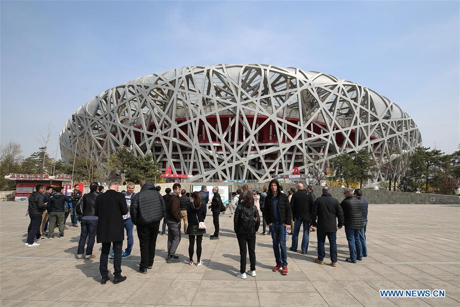 Photo taken on April 8, 2019 shows representatives from major world news agencies on the Olympic Green in front of the National Stadium during a venue visit prior to the First World Agency Meeting of Beijing 2022, in Beijing, capital of China. Representatives from major world news agencies are visiting Beijing for a first look at some of the facilities to be used at the 2022 Winter Olympic Games. (Xinhua/Xu Zijian)