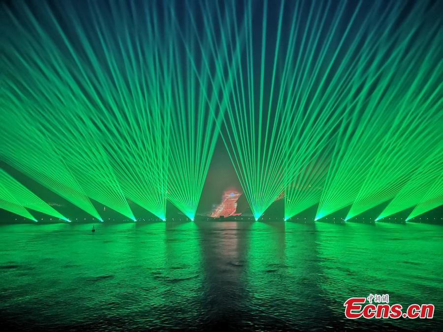 A stunning light show is staged in Wenzhou City, Zhejiang Province, April 8, 2019. The light show has made use of the Shengmeijian Mountain and water area as well as the city\'s buildings to present different light effects. The show covers a mountain area of 9.5 million square meters, and is said to be the largest such project in China. (Photo: China News Service/Zhang Yin)