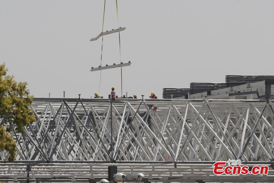 Construction of Tesla\'s Shanghai Gigafactory 3 is in full swing, April 8, 2019. Several sets of steel structural roof frames have been installed. The new plant, Tesla\'s first outside the United States, is located in Lingang Area, a high-end manufacturing park in the southeast harbor of Shanghai. It is designed to have an annual capacity to create 500,000 electric cars. (Photo: China News Service/Zhang Hengwei)