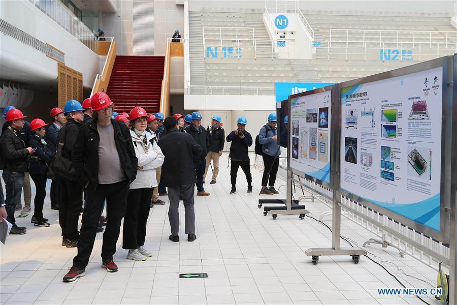 Photo taken on April 8, 2019 shows representatives from major world news agencies in the National Aquatics Center during a venue visit prior to the First World Agency Meeting of Beijing 2022, in Beijing, capital of China. Representatives from major world news agencies are visiting Beijing for a first look at some of the facilities to be used at the 2022 Winter Olympic Games. (Xinhua/Xu Zijian)