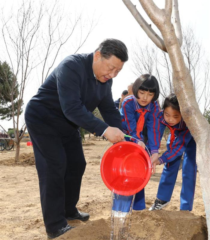 Chinese President Xi Jinping, also general secretary of the Communist Party of China Central Committee and chairman of the Central Military Commission, waters a sapling with school children as he attends a tree-planting activity in Tongzhou District in Beijing, capital of China, April 8, 2019. Other Party and state leaders, including Li Zhanshu, Wang Yang, Wang Huning, Zhao Leji, Han Zheng and Wang Qishan, also attended the activity. (Xinhua/Ju Peng)