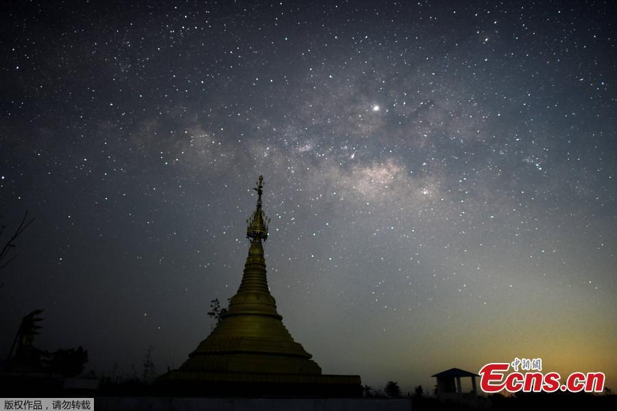Long-exposure pictures captured the Milky Way spreading shining stars in the sky of Taikkyi, Myanmar early on April 9, 2019. (Photo/Agencies)