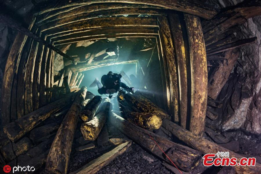 Photographer Martin Strmiska dived the Slovak Opal Mines, which has many tunnels, shafts and adits excavated in the volcanic hills. Five lowest levels are flooded, offering an incredible experience when diving in completely crystal clear water.(Photo/IC)