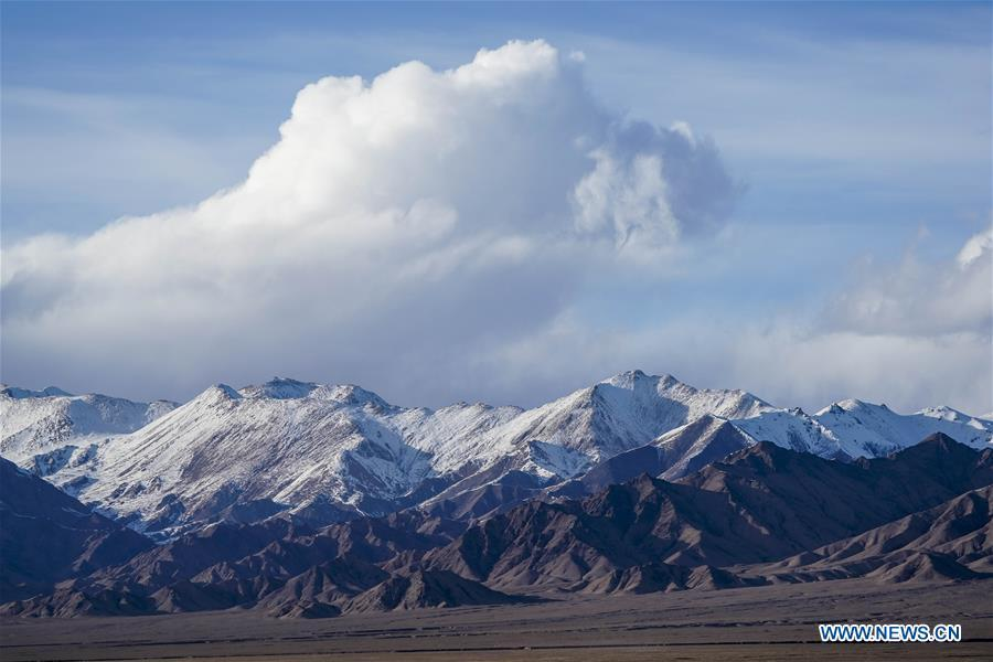 Photo taken on March 30, 2019 shows snow mountains in the Altun Mountains National Nature Reserve in northwest China\'s Xinjiang Uygur Autonomous Region. Altun Mountain National Nature Reserve saw the number of three rare wild animals reach around 100,000, according to local researchers. The population of wild yak, Tibetan antelope and wild ass is recovering to the level of recorded data in the 1980s when the reserve was first set up, the results of the latest scientific investigation showed. The reserve suspended all mining activities within its 46,800-square-km parameter in 2018 in an effort to restore its environment. (Xinhua/Hu Huhu)