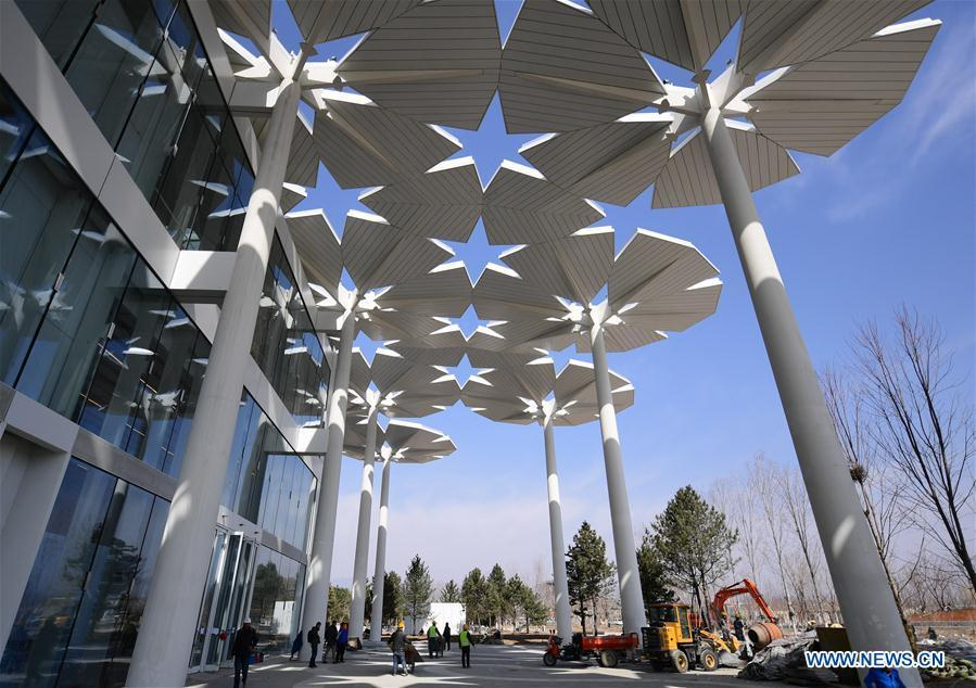 Photo taken on March 26, 2019 shows the International Pavilion being arranged at the site of the International Horticultural Exhibition 2019 Beijing China in Yanqing district of Beijing, capital of China. (Photo/Xinhua) International Pavilion  Indoor exhibitions and plant competitions will unfold at the International Pavilion. Blossoms are weaved into 94 umbrellas to create a sea of flowers. This floral ocean opens up as an enormous sunshade, shielding the area from the summer heat to provide a pleasant recreational area. When evening falls, it lights up and transforms into a spectacular night view of colors.