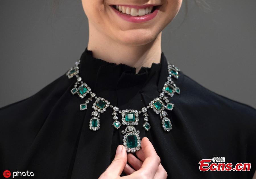 A model wears a 19th century emerald and diamond fringe necklace, during a media opportunity at Christie\'s auction rooms in London, Tuesday, April 9, 2019. The necklace estimated at 1,500,000-2,500,000 US dollars will be sold at the Geneva Magnificent Jewels auction on May 15. (Photo/IC)