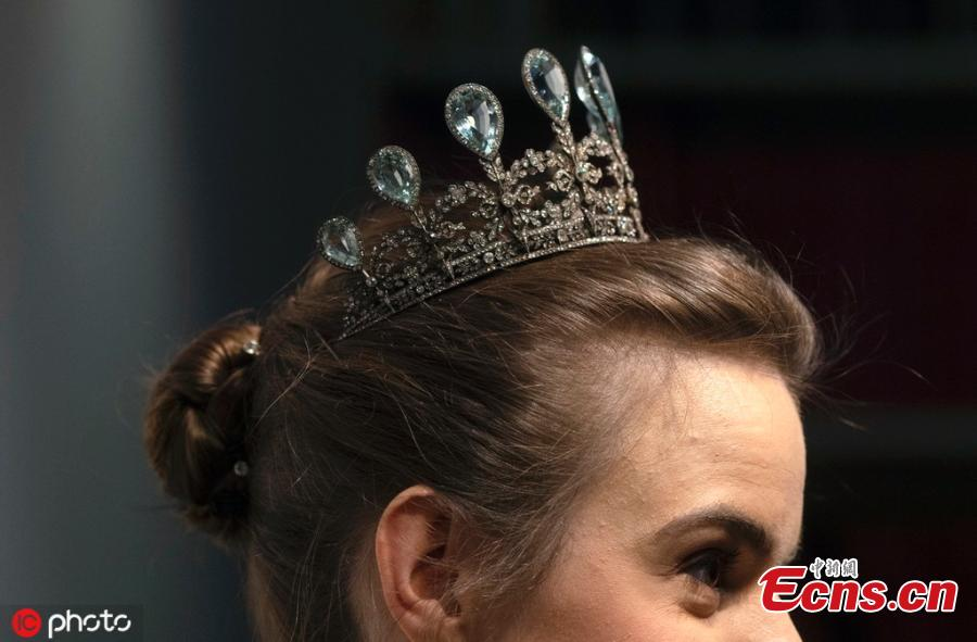 A model wears a rare aquamarine and diamond tiara by Faberge, at Christie\'s auction rooms in London, Tuesday, April 9, 2019. The tiara estimated at 230,000-340,000 US dollars will be sold at the Geneva Magnificent Jewels auction on May 15. (Photo/IC)