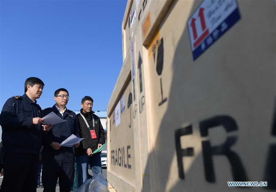 Customs officers handle formalities for Chinese cultural relics transported from Italy at Beijing International Airport in Beijing, capital of China, April 10, 2019. A total of 796 Chinese cultural relics arrived at Beijing International Airport at 6:54 a.m. Wednesday after an eight-hour flight from Italy. The group of Chinese artifacts were first noticed by a unit of Carabinieri, or the national gendarmerie of Italy, on the local relics auction market in 2007, which was followed by a domestic judicial trial. (Xinhua/Li He)