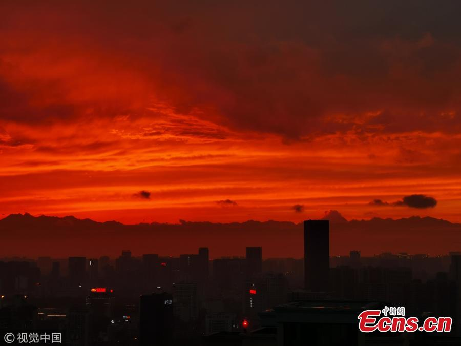 Buildings silhouetted at sunset in Chengdu City, Sichuan Province, April 10, 2019. (Photo/VCG)