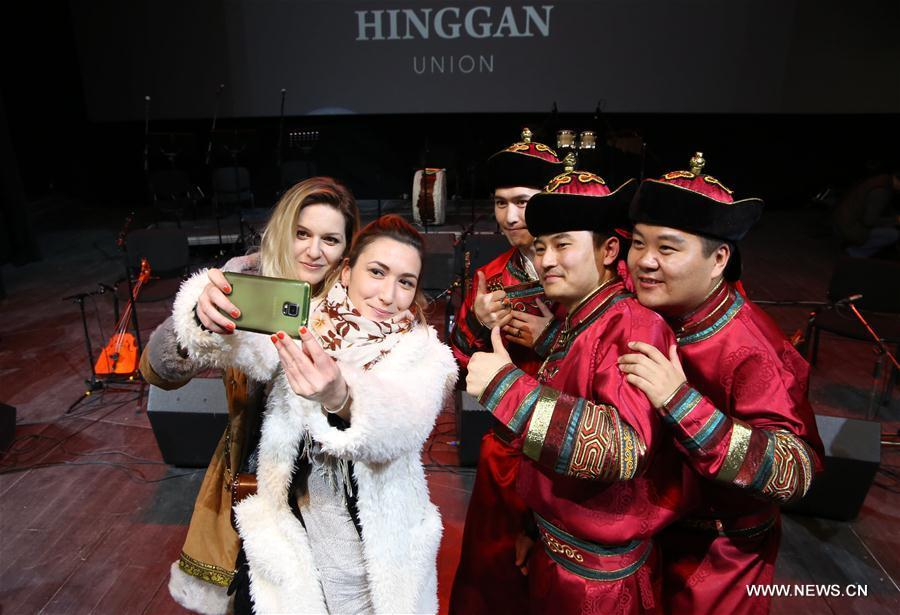 Serbian audiences take selfies with members of the Hinggan Primitive Music Ensemble from China\'s Inner Mongolia after the performance in Belgrade, capital of Serbia, Feb. 16, 2019. Hundreds of local visitors enjoyed the performance which was part of the \