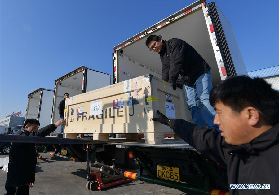 Logistics staff load Chinese cultural relics transported from Italy, which have been cleared by the customs, into trucks, at Beijing International Airport in Beijing, capital of China, April 10, 2019. A total of 796 Chinese cultural relics arrived at Beijing International Airport at 6:54 a.m. Wednesday after an eight-hour flight from Italy. The group of Chinese artifacts were first noticed by a unit of Carabinieri, or the national gendarmerie of Italy, on the local relics auction market in 2007, which was followed by a domestic judicial trial. (Xinhua/Li He)