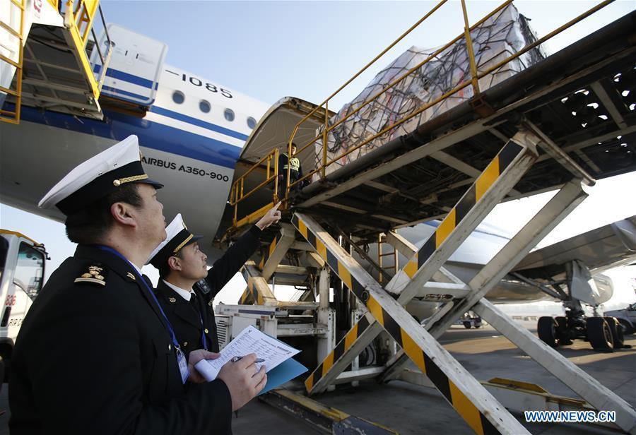 Customs officers supervise the unloading process of Chinese cultural relics transported from Italy at Beijing International Airport in Beijing, capital of China, April 10, 2019. A total of 796 Chinese cultural relics arrived at Beijing International Airport at 6:54 a.m. Wednesday after an eight-hour flight from Italy. The group of Chinese artifacts were first noticed by a unit of Carabinieri, or the national gendarmerie of Italy, on the local relics auction market in 2007, which was followed by a domestic judicial trial. (Xinhua/Chen Yinsong)