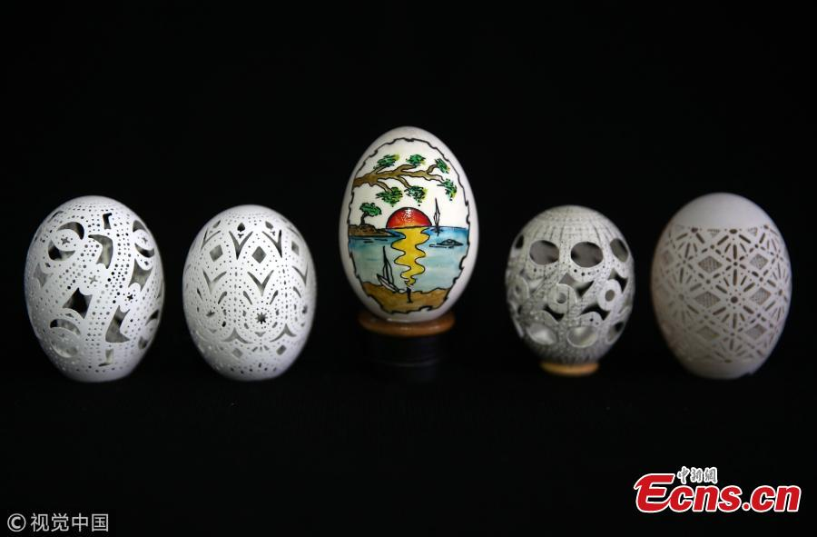 Chicken eggs, carved by Naci Eroglu 60-year-old are seen at his workshop in Adana, Turkey on April 9, 2019. (Photo/VCG)