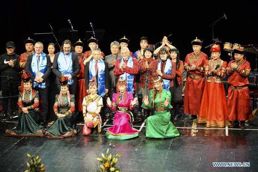 Croatian Former President Stjepan Mesic (C) and Chinese Ambassador to Croatia Hu Zhaoming pose with members of Hinggan Folk Music Ensemble in Varazdin, Croatia, Feb. 12, 2019. \
