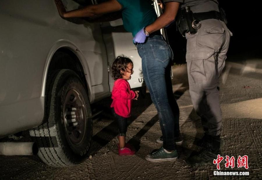 World Press Photo of the Year  John Moore\'s award-winning photo shows a two-year-old Honduran asylum seeker cries as her mother is searched and detained near the U.S.-Mexico border on June 12, 2018. (Photo: John Moore/Getty Images)