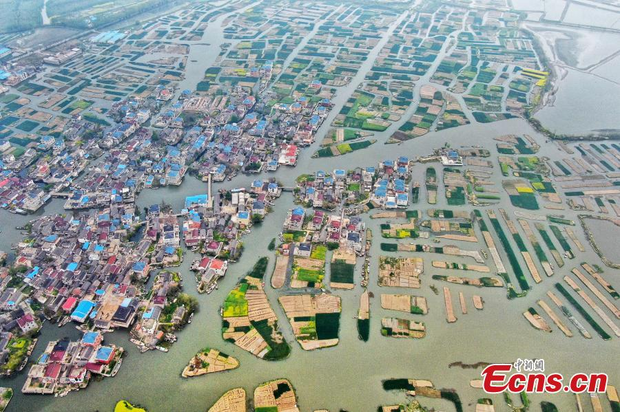 An aerial view of colorful fields crisscrossed by water in a rural area in Xinghua City, East China\'s Jiangsu Province, April 10, 2019. Locals have a tradition of digging mud from trenches or small rivers to form small plots of land. (Photo: China News Service/Yang Bo)