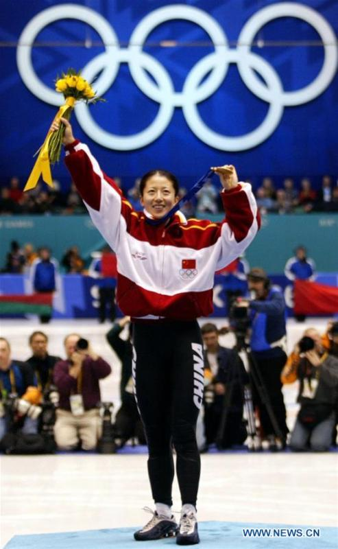 File photo taken on Feb. 16, 2002 shows China\'s Yang Yang celebrating on the podium during the awarding ceremony of the women\'s 500m event of short track speed skating at 2002 Winter Olympic Games in Salt Lake City, the United States. Yang Yang won the gold medal of the event and it was China\'s first Winter Olympic gold medal. From sending athletes to Helsinki Summer Olympic Games for the very first time in 1952 to winning the bid to host 2022 Winter Olympic Games in 2015, the People\'s Republic of China went through a remarkable history of sports, including successfully hosting the 2008 Summer Olympic Games and preparing for the upcoming 2022 Winter Olympic Games. (Xinhua/Luo Gengqian)