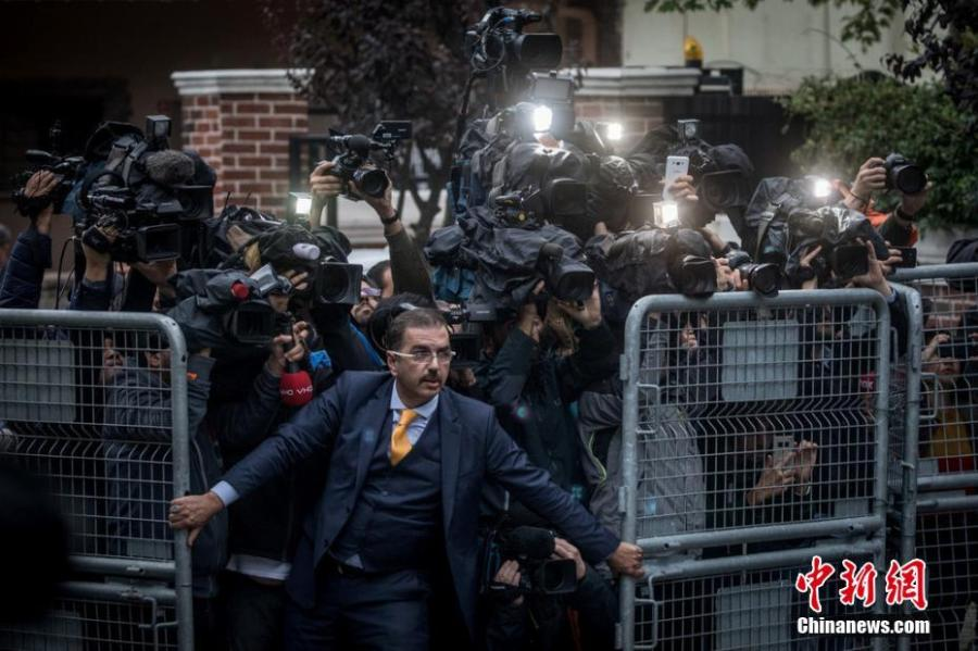 General news, singles winner  An unidentified man tries to hold back the press as investigators arrive at the Saudi Arabian consulate ahead of Turkish police amid a growing international backlash to the disappearance of the journalist Jamal Khashoggi in Istanbul, Turkey.  Photograph: Chris McGrath/Getty Images