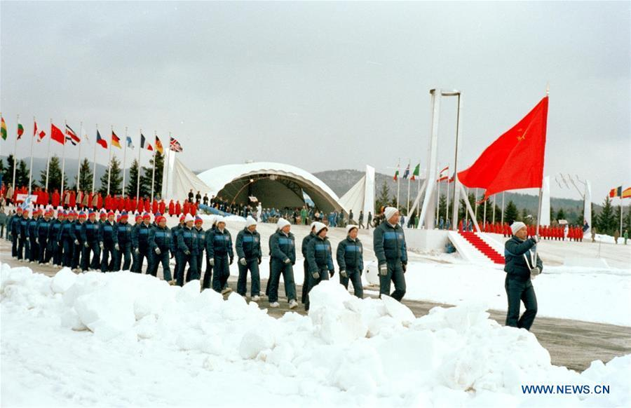 File photo taken on Feb. 13, 1980 shows Chinese delegation marching into the venue during the opening ceremony of the 13th Winter Olympic Games held in Lake Placid Stadium, the United States. This was the first time the People\'s Republic of China compete in the Winter Olympic Games. From sending athletes to Helsinki Summer Olympic Games for the very first time in 1952 to winning the bid to host 2022 Winter Olympic Games in 2015, the People\'s Republic of China went through a remarkable history of sports, including successfully hosting the 2008 Summer Olympic Games and preparing for the upcoming 2022 Winter Olympic Games. (Xinhua/Xia Daoling)