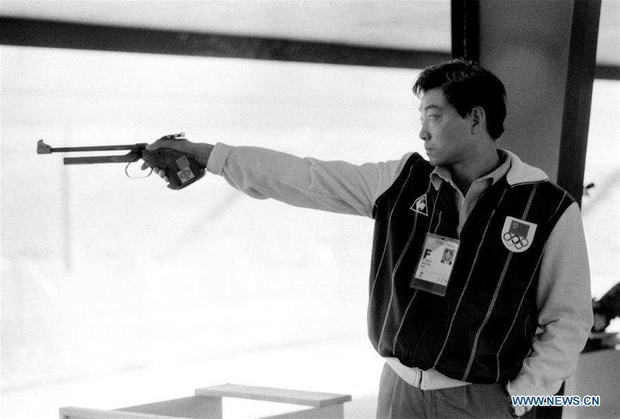 File photo taken on July 29, 1984 shows that China\'s Xu Haifeng compete in the men\'s pistol event at the 23rd Olympic Games in Los Angeles, the United States. Xu Haifeng won the gold medal of the event which was China\'s first Olympic gold medal. From sending athletes to Helsinki Summer Olympic Games for the very first time in 1952 to winning the bid to host 2022 Winter Olympic Games in 2015, the People\'s Republic of China went through a remarkable history of sports, including successfully hosting the 2008 Summer Olympic Games and preparing for the upcoming 2022 Winter Olympic Games. (Xinhua/Guan Tianyi)