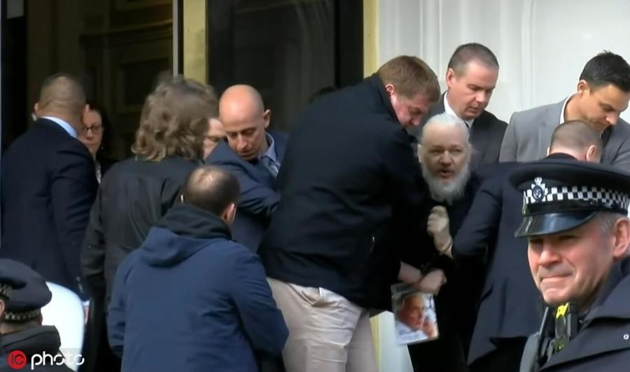 WikiLeaks founder Julian Assange is forcibly removed by British police from Ecuadorian embassy, April 11, 2019. British police dragged WikiLeaks founder Julian Assange out of Ecuador\'s embassy on Thursday after his seven-year asylum was revoked, paving the way for his extradition to the United States for one of the biggest ever leaks of classified information. (Photo/IC)