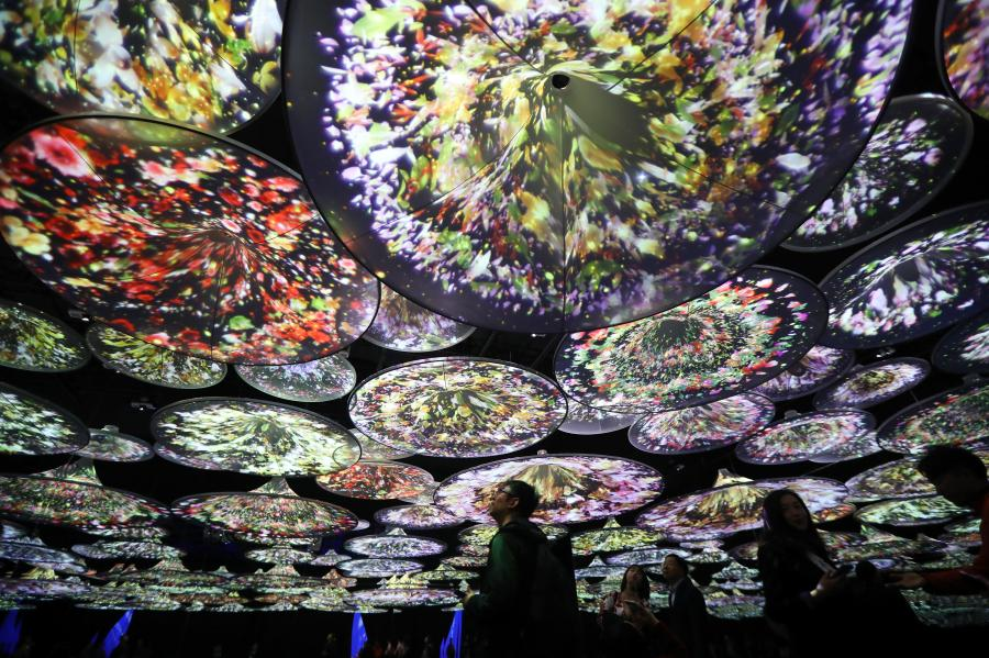 An interactive art installation project that draws inspiration from three famous paintings in Chinese history opens at a gallery in Deji Plaza, an upscale office and shopping mall complex in Nanjing, Jiangsu Province, April 11, 2019. Visitors appear to immerse themselves into scenes in the paintings. The three scrolls included \
