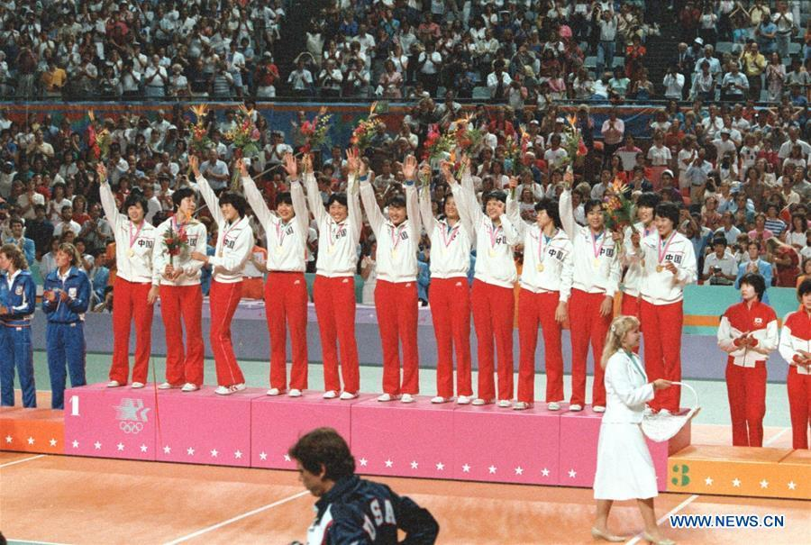 File photo taken on August 7, 1984 Chinese women\'s volleyball team celebrating on the podium during the awarding ceremony after winning the final against the United States at the 23rd Olympic Games in Los Angeles, the United States. From sending athletes to Helsinki Summer Olympic Games for the very first time in 1952 to winning the bid to host 2022 Winter Olympic Games in 2015, the People\'s Republic of China went through a remarkable history of sports, including successfully hosting the 2008 Summer Olympic Games and preparing for the upcoming 2022 Winter Olympic Games. (Xinhua/Hu Yue)