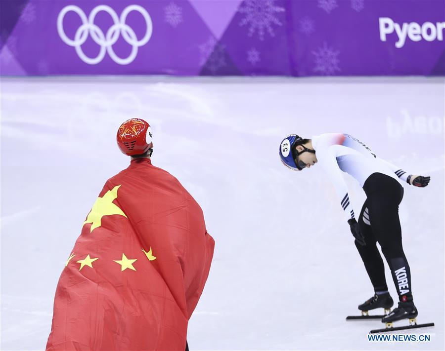 File photo taken on Feb. 22, 2018 shows China\'s Wu Dajing (L) celebrating victory after men\'s 500m final of short track speed skating at the 2018 PyeongChang Winter Olympic Games at Gangneung Ice Arena, Gangneung, South Korea. Wu Dajing is China\'s first male Winter Olympic gold medalist. From sending athletes to Helsinki Summer Olympic Games for the very first time in 1952 to winning the bid to host 2022 Winter Olympic Games in 2015, the People\'s Republic of China went through a remarkable history of sports, including successfully hosting the 2008 Summer Olympic Games and preparing for the upcoming 2022 Winter Olympic Games. (Xinhua/Lan Hongguang)