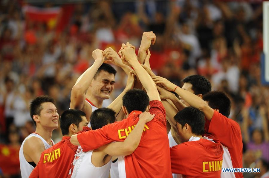 File photo taken on August 16, 2008 shows China\'s Yao Ming celebrates with teammates after winning the basketball match against Germany at 2008 Beijing Olympic Games. From sending athletes to Helsinki Summer Olympic Games for the very first time in 1952 to winning the bid to host 2022 Winter Olympic Games in 2015, the People\'s Republic of China went through a remarkable history of sports, including successfully hosting the 2008 Summer Olympic Games and preparing for the upcoming 2022 Winter Olympic Games. (Xinhua/Li Jundong)