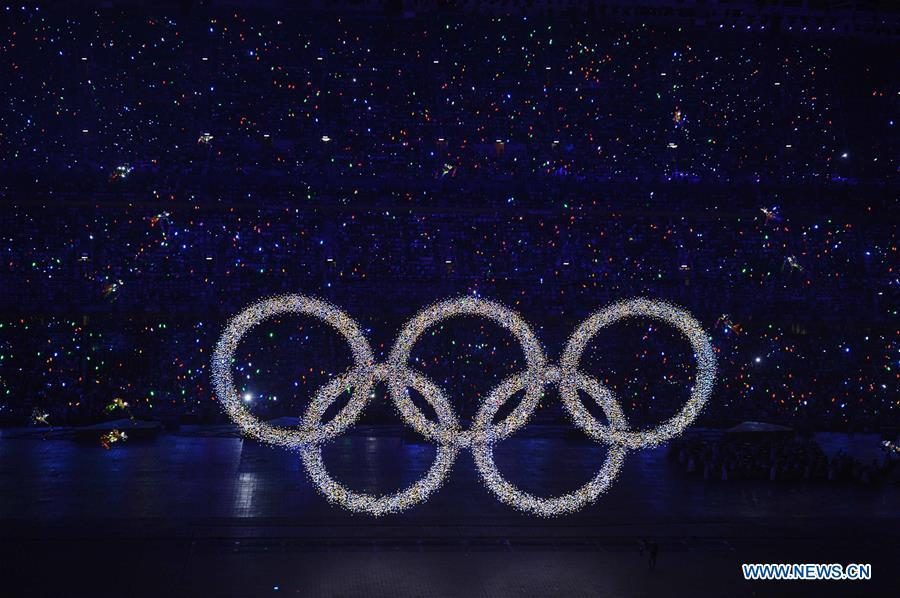Photo taken on Aug. 8, 2008 shows the shining Olympic rings on a huge LED screen, proclaiming the arrival of the Olympiad, during the opening ceremony of the Beijing 2008 Olympic Games in the National Stadium, or the Bird\'s Nest, Beijing, capital of China. From sending athletes to Helsinki Summer Olympic Games for the very first time in 1952 to winning the bid to host 2022 Winter Olympic Games in 2015, the People\'s Republic of China went through a remarkable history of sports, including successfully hosting the 2008 Summer Olympic Games and preparing for the upcoming 2022 Winter Olympic Games. (Xinhua/Yang Lei)