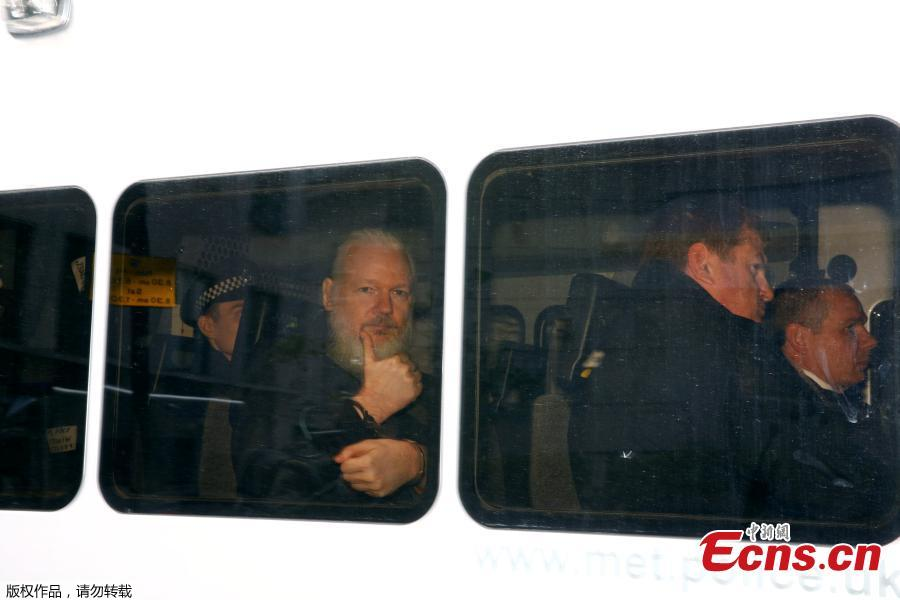 WikiLeaks founder Julian Assange arrives at the Westminster Magistrates Court, after he was arrested in London, Britain, April 11, 2019. British police dragged WikiLeaks founder Julian Assange out of Ecuador\'s embassy on Thursday after his seven-year asylum was revoked, paving the way for his extradition to the United States for one of the biggest ever leaks of classified information. (Photo/Agencies)