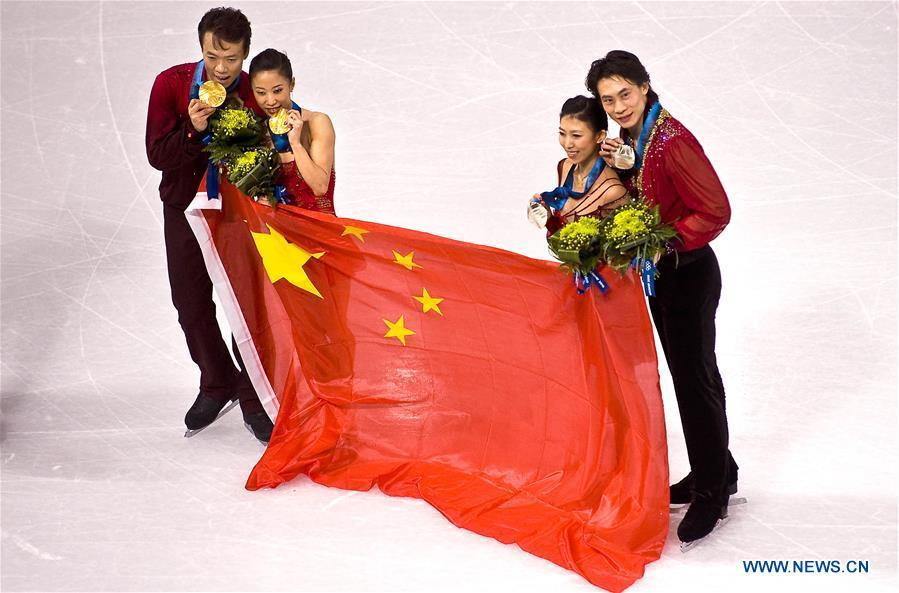 File photo taken on Feb. 15, 2010 shows gold medalists Shen Xue (2nd L) and Zhao Hongbo (1st L) of China, compatriots and silver medalists Pang Qing (2nd R) and Tong Jian pose with the Chinese national flag during the medals ceremony for the figure skating pairs event at the 2010 Winter Olympics at the Pacific Coliseum in Vancouver, Canada. Shen Xue/Zhao Hongbo won the China\'s first Olympic gold medal in figure skating. From sending athletes to Helsinki Summer Olympic Games for the very first time in 1952 to winning the bid to host 2022 Winter Olympic Games in 2015, the People\'s Republic of China went through a remarkable history of sports, including successfully hosting the 2008 Summer Olympic Games and preparing for the upcoming 2022 Winter Olympic Games. (Xinhua/Chen Xiaowei)