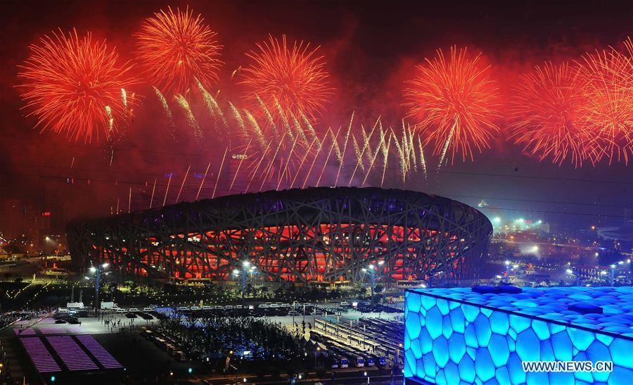File photo taken on August 8, 2008 shows the fireworks displayed during the opening ceremony of the Beijing Olympic Games held in the National Stadium, also known as the Bird\'s Nest, in Beijing, capital of China. From sending athletes to Helsinki Summer Olympic Games for the very first time in 1952 to winning the bid to host 2022 Winter Olympic Games in 2015, the People\'s Republic of China went through a remarkable history of sports, including successfully hosting the 2008 Summer Olympic Games and preparing for the upcoming 2022 Winter Olympic Games. (Xinhua/Chen Kai)
