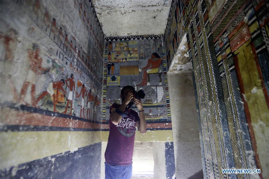 A man takes photos in a tomb in Saqqara, Egypt on April 13, 2019. Egyptian Ministry of Antiquities opened on Saturday a tomb of a Fifth Dynasty dignitary which was discovered recently at Saqqara Necropolis near the Giza pyramids. Minister of Antiquities Khaled al-Anany, along with 52 ambassadors and cultural attaches of foreign, Arab and African countries, toured Saqqara Necropolis to inspect the tomb of Khuwy, who lived at the end of the Fifth Dynasty of the Old Kingdom. The Old Kingdom of Egypt is the period spanning 2686 BC to 2181 BC, which is also known as the Age of the Pyramids. (Xinhua/Ahmed Gomaa)