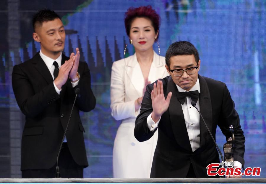 Wen Muye, the director of film Dying to Survive, wins the Hong Kong Film Award for Best Film from Mainland and Taiwan at this year\'s Hong Kong Film Awards, April 14, 2019. Crime thriller Project Gutenberg was the night's biggest winner, bagging seven awards, including best film, after receiving 17 nominations. (Photo: China News Service/Zhang Wei)