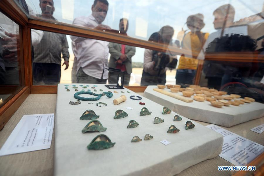 People look at the unearthed artifacts in a tomb in Saqqara, Egypt on April 13, 2019. Egyptian Ministry of Antiquities opened on Saturday a tomb of a Fifth Dynasty dignitary which was discovered recently at Saqqara Necropolis near the Giza pyramids. Minister of Antiquities Khaled al-Anany, along with 52 ambassadors and cultural attaches of foreign, Arab and African countries, toured Saqqara Necropolis to inspect the tomb of Khuwy, who lived at the end of the Fifth Dynasty of the Old Kingdom. The Old Kingdom of Egypt is the period spanning 2686 BC to 2181 BC, which is also known as the Age of the Pyramids. (Xinhua/Ahmed Gomaa)
