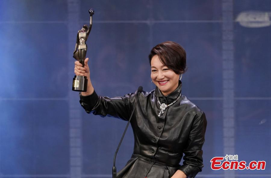 Hong Kong film star Kara Hui Ying-hung receives the Best Supporting Actress at this year\'s Hong Kong Film Awards, April 14, 2019.  Crime thriller Project Gutenberg was the night's biggest winner, bagging seven awards, including best film, after receiving 17 nominations. (Photo: China News Service/Zhang Wei)