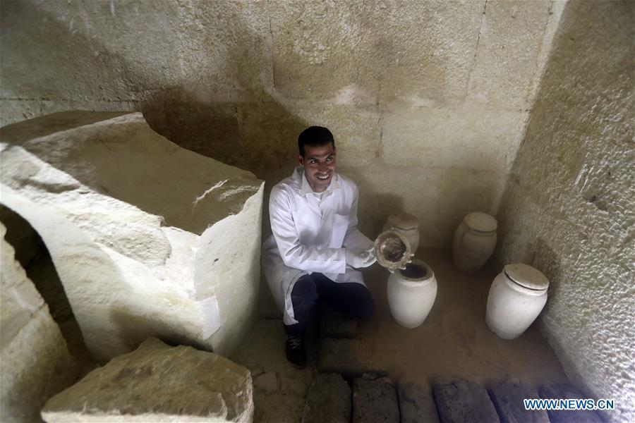 An archeologist works in a tomb in Saqqara, Egypt on April 13, 2019. Egyptian Ministry of Antiquities opened on Saturday a tomb of a Fifth Dynasty dignitary which was discovered recently at Saqqara Necropolis near the Giza pyramids. Minister of Antiquities Khaled al-Anany, along with 52 ambassadors and cultural attaches of foreign, Arab and African countries, toured Saqqara Necropolis to inspect the tomb of Khuwy, who lived at the end of the Fifth Dynasty of the Old Kingdom. The Old Kingdom of Egypt is the period spanning 2686 BC to 2181 BC, which is also known as the Age of the Pyramids. (Xinhua/Ahmed Gomaa)