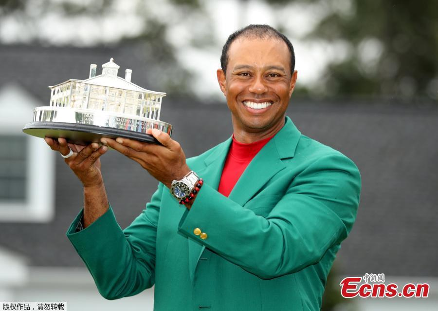 Tiger Woods celebrates with his fifth green jacket after winning the 2019 Masters Tournament at the Augusta National Golf Club in Augusta, Georgia, on April 14, 2019. (Photo/Agencies)