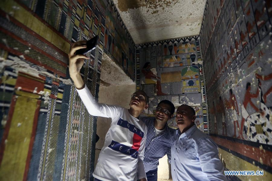 People take selfies in a tomb in Saqqara, Egypt on April 13, 2019. Egyptian Ministry of Antiquities opened on Saturday a tomb of a Fifth Dynasty dignitary which was discovered recently at Saqqara Necropolis near the Giza pyramids. Minister of Antiquities Khaled al-Anany, along with 52 ambassadors and cultural attaches of foreign, Arab and African countries, toured Saqqara Necropolis to inspect the tomb of Khuwy, who lived at the end of the Fifth Dynasty of the Old Kingdom. The Old Kingdom of Egypt is the period spanning 2686 BC to 2181 BC, which is also known as the Age of the Pyramids. (Xinhua/Ahmed Gomaa)