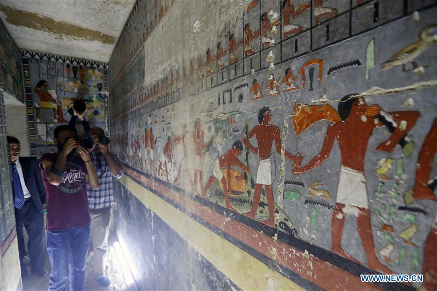 People visit a tomb in Saqqara, Egypt on April 13, 2019. Egyptian Ministry of Antiquities opened on Saturday a tomb of a Fifth Dynasty dignitary which was discovered recently at Saqqara Necropolis near the Giza pyramids. Minister of Antiquities Khaled al-Anany, along with 52 ambassadors and cultural attaches of foreign, Arab and African countries, toured Saqqara Necropolis to inspect the tomb of Khuwy, who lived at the end of the Fifth Dynasty of the Old Kingdom. The Old Kingdom of Egypt is the period spanning 2686 BC to 2181 BC, which is also known as the Age of the Pyramids. (Xinhua/Ahmed Gomaa)