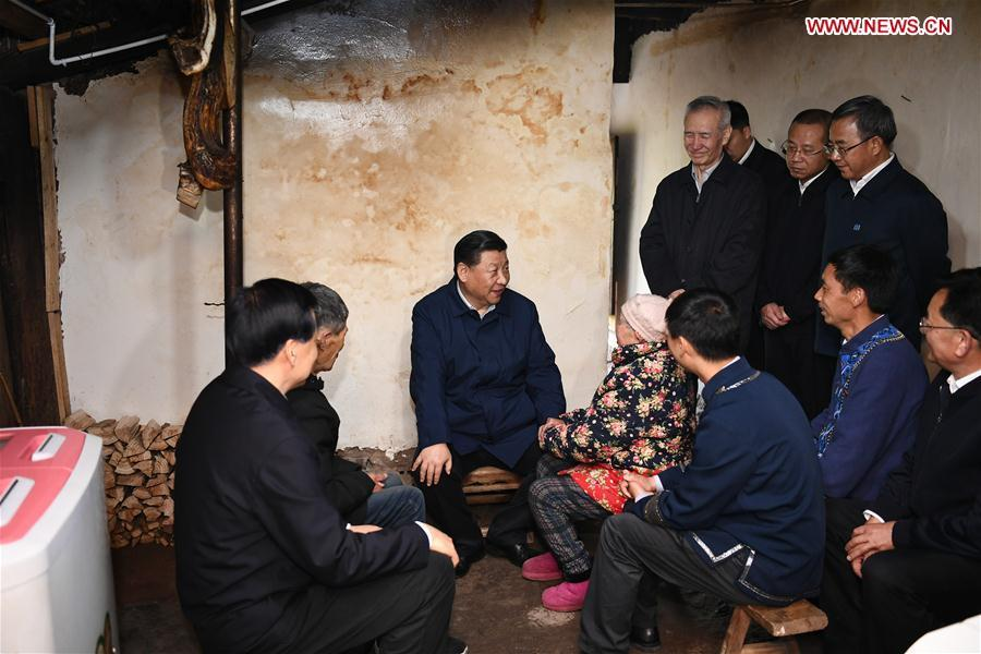 Chinese President Xi Jinping, also general secretary of the Communist Party of China Central Committee and chairman of the Central Military Commission, visits a villager\'s home to learn about the progress of poverty alleviation and in solving prominent problems including meeting the basic need of food and clothing and guaranteeing compulsory education, basic medical care and safe housing, in Huaxi Village of Shizhu Tujia Autonomous County, southwest China\'s Chongqing, April 15, 2019. Xi went on an inspection tour in southwest China\'s Chongqing Municipality Monday. (Xinhua/Xie Huanchi)