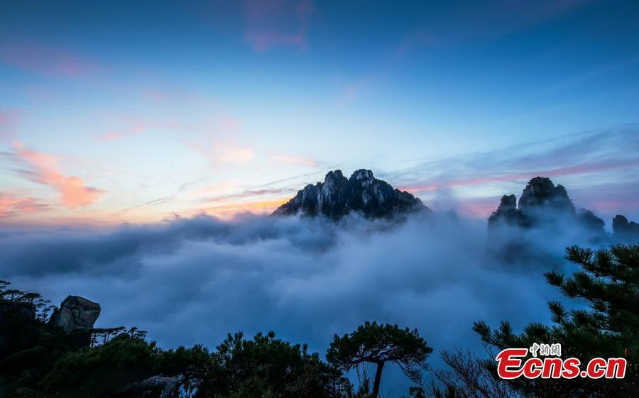 Clouds surround Mount Sanqing in Jiangxi Province. Mount Sanqing National Park is a UNESCO world heritage site, known for its exceptional scenic quality, marked by a concentration of fantastically shaped pillars and peaks. (Photo: China News Service/Zheng Xiaiping)