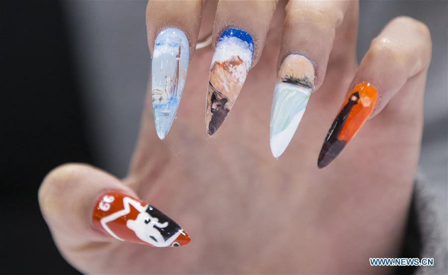 A model displays her nail fashion during the Nail Art Challenge at the 2019 Revel in Beauty event in Toronto, Canada, on April 15, 2019. The Nail Art Challenge was held on Monday to showcase the creative process of nail art to spectators. (Xinhua/Zou Zheng)