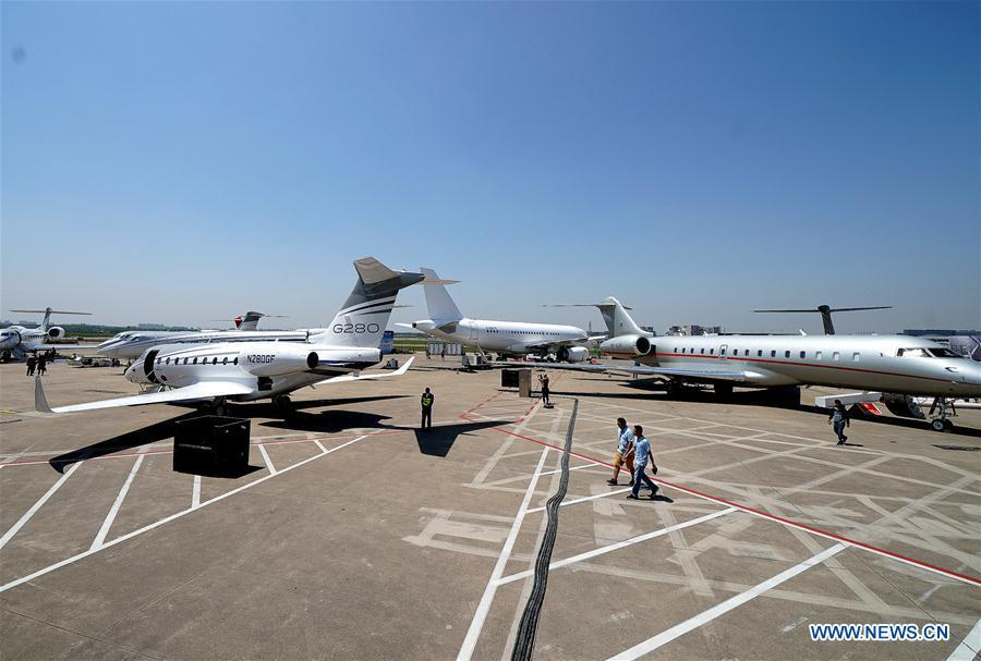 Business aircrafts are parked on the tarmac for the upcoming 2019 Asian Business Aviation Conference & Exhibition at Shanghai Hongqiao International Airport in east China\'s Shanghai, April 15, 2019. The 2019 Asian Business Aviation Conference & Exhibition (ABACE) will be held from April 16 to 18 at a business aviation service center of Shanghai Hongqiao International Airport. The event is participated by about 150 global exhibitors showcasing more than 30 aircrafts. (Xinhua/Chen Fei)