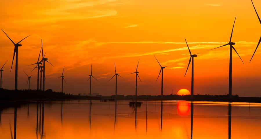 Wind turbines erected in water at a wind farm.(Photo/Tianjin Municipal Information Office)